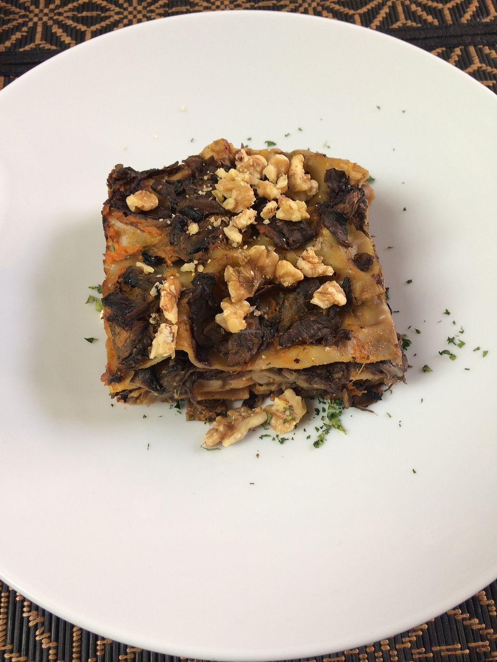 """Photo of Giardino Tergesteo  by <a href=""""/members/profile/siderealfire"""">siderealfire</a> <br/>Vegan  bran lasagna with pumpkin béchamel, mushrooms, radicchio and topped with walnuts <br/> February 25, 2018  - <a href='/contact/abuse/image/84598/363582'>Report</a>"""