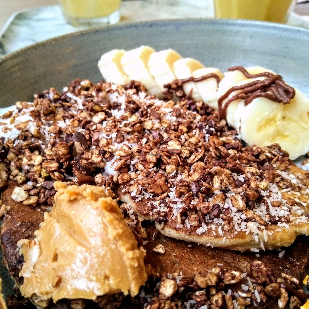 """Photo of O'yo  by <a href=""""/members/profile/Zjef"""">Zjef</a> <br/>The Co'Yo Crazy vegan pancakes with coconut yoghurt, peanut butter, banana, maple syrup and chocolate sauce <br/> March 17, 2018  - <a href='/contact/abuse/image/84655/371738'>Report</a>"""