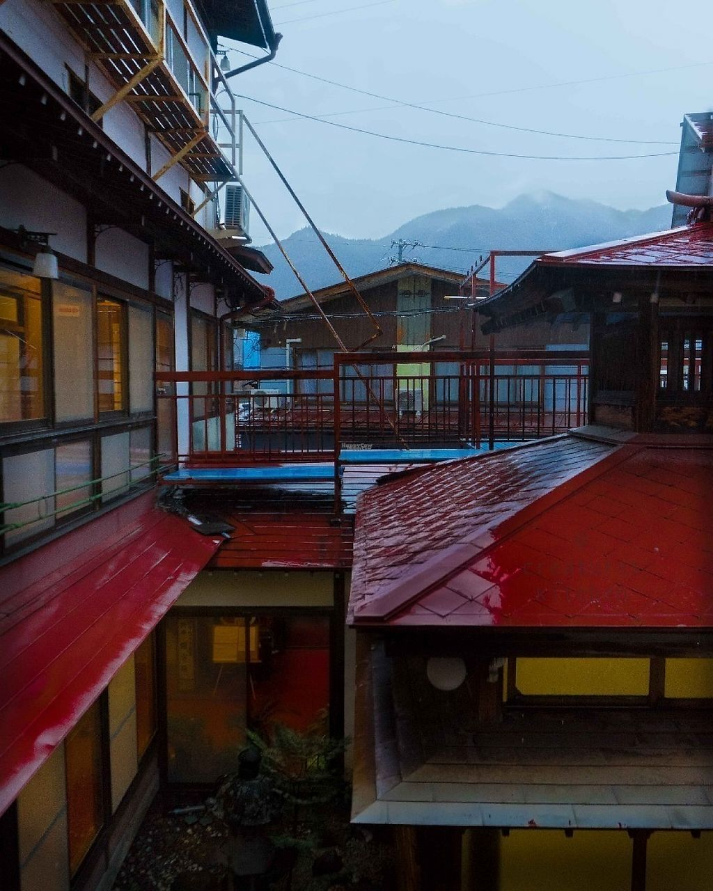 """Photo of Yudakana Onsen Seifuso  by <a href=""""/members/profile/EmmaCebuliak"""">EmmaCebuliak</a> <br/>View from a guest room overlooking the Japanese style court yard and one of the bathhouses.  <br/> January 20, 2017  - <a href='/contact/abuse/image/84950/213552'>Report</a>"""