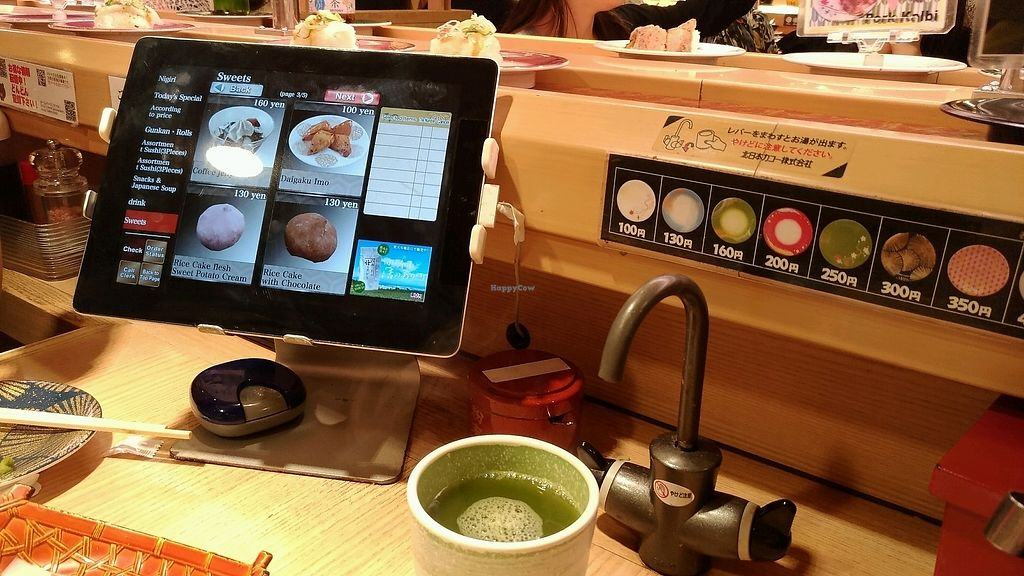 """Photo of Katsu Midori Sushi Shibuya  by <a href=""""/members/profile/chocomelonhead"""">chocomelonhead</a> <br/>green tea and tablet <br/> September 5, 2017  - <a href='/contact/abuse/image/84977/301043'>Report</a>"""
