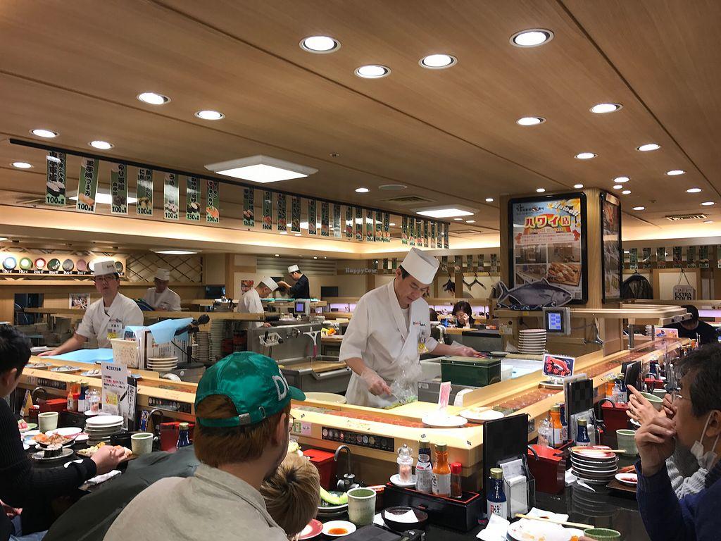"Photo of Katsu Midori Sushi Shibuya  by <a href=""/members/profile/chris10kors"">chris10kors</a> <br/>Sushi chefs behind the conveyor belt <br/> January 30, 2018  - <a href='/contact/abuse/image/84977/352657'>Report</a>"