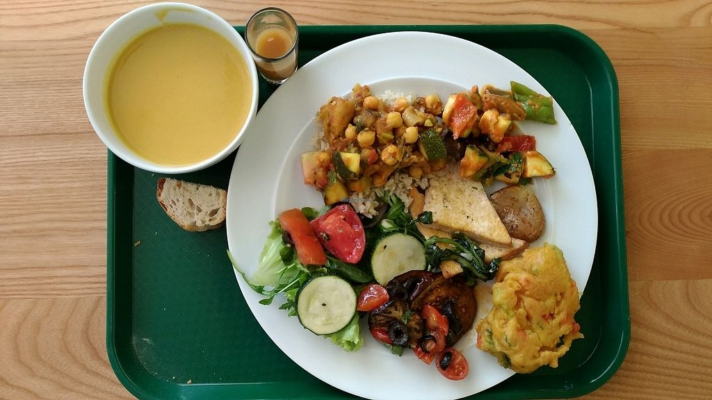 """Photo of DaTerra - Bom Sucesso Market  by <a href=""""/members/profile/MairaS"""">MairaS</a> <br/>Onion and carrot soup. Some of the thinga in the plate: baked veggies, tofu with potato, chickpea caril, roasted eggplant, salad <br/> September 19, 2017  - <a href='/contact/abuse/image/85008/306068'>Report</a>"""