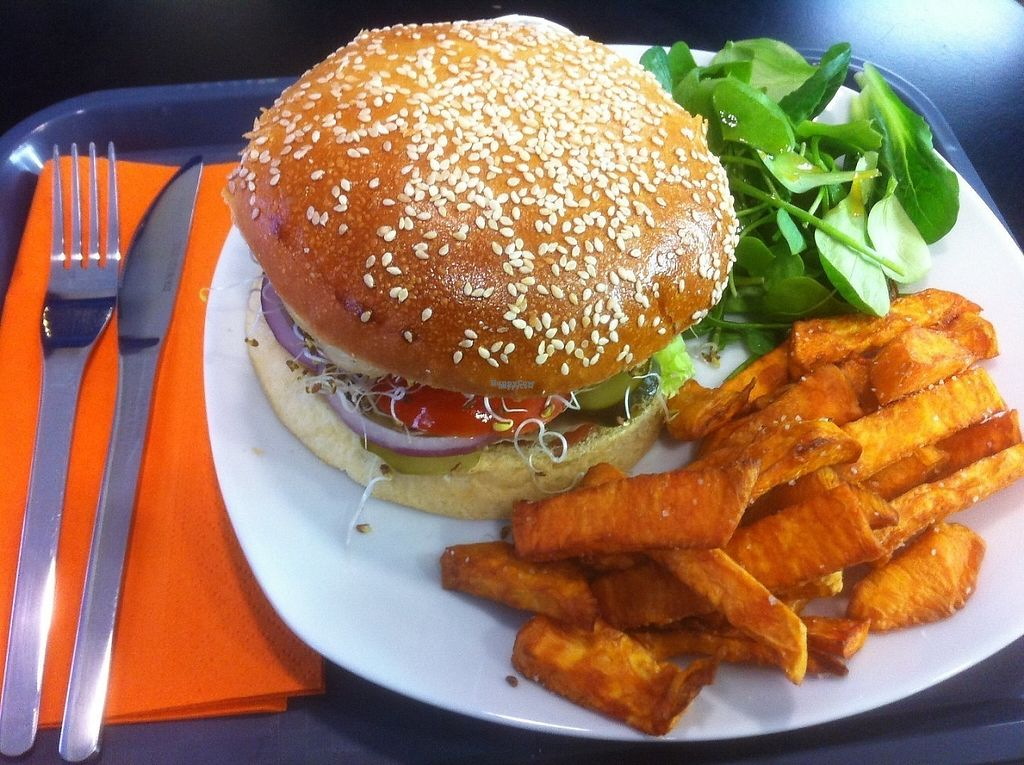 """Photo of Chic Planete  by <a href=""""/members/profile/Sebastien"""">Sebastien</a> <br/>Veggie Burger with salad, tomatoes, dill pickles, red onions, grilled mushrooms and homemade BBQ sauce. Served with sweet potatoes fries and a small salad with special dressing (Tamari sauce and Maple sirup). 10 euros with an organic soda ! <br/> February 2, 2017  - <a href='/contact/abuse/image/85341/220752'>Report</a>"""