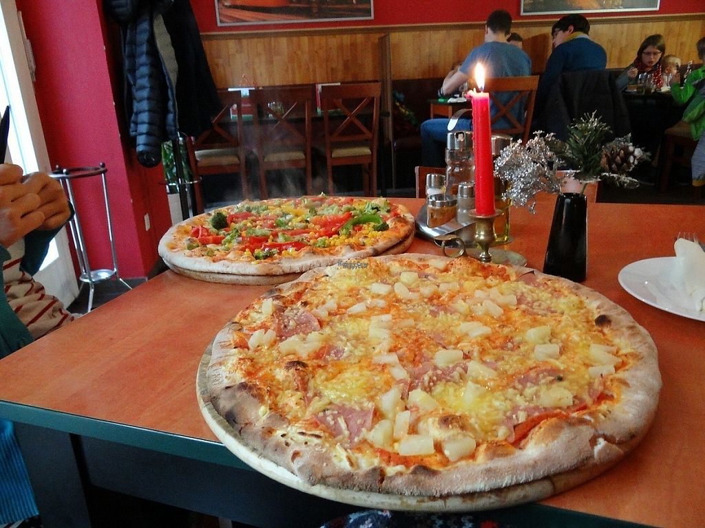 """Photo of Roma Ristorante Pizzeria  by <a href=""""/members/profile/Sternanis"""">Sternanis</a> <br/>Vegan Hawaiian pizza in the front, broccoli pizza without cheese in the back.  <br/> January 11, 2017  - <a href='/contact/abuse/image/85367/210568'>Report</a>"""