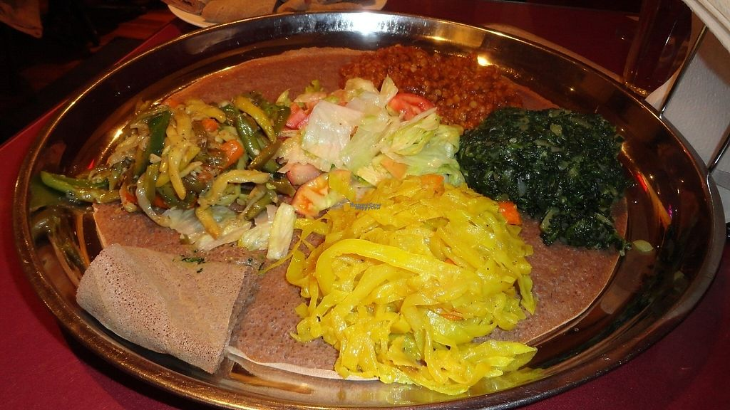 """Photo of Habesha  by <a href=""""/members/profile/Allan%26Michelle"""">Allan&Michelle</a> <br/>Selection of 4 vegetarian/vegan dishes + (salad that is sometimes included) We always order 4 dishes and take home enough Injera and food to have lunch the next day <br/> January 29, 2017  - <a href='/contact/abuse/image/85677/219402'>Report</a>"""