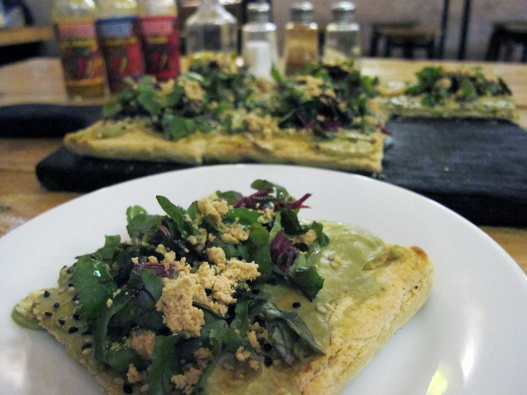 """Photo of Las Gringas  by <a href=""""/members/profile/dd.boa7"""">dd.boa7</a> <br/>gluten free vegan pizza. The crust is made of tapioca, cornmeal and rice. The topping consists of avocado cheese, sesame seeds, beetroot leaves, cashew parmesan, and olive oil.  <br/> March 18, 2018  - <a href='/contact/abuse/image/86094/372458'>Report</a>"""