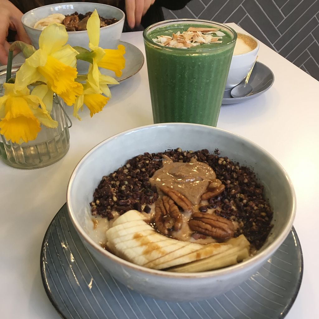 """Photo of Brochan  by <a href=""""/members/profile/SarahMoyes"""">SarahMoyes</a> <br/>Green smoothie and porridge topped with banana, granola and caramel sauce  <br/> April 18, 2018  - <a href='/contact/abuse/image/86136/387767'>Report</a>"""
