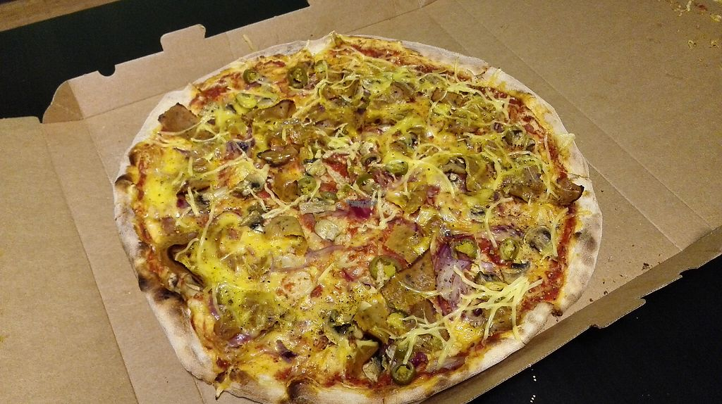 """Photo of Pizza Express  by <a href=""""/members/profile/VeganVenturer"""">VeganVenturer</a> <br/>Home delivered XL-sized seitan pizza 20 € <br/> February 8, 2017  - <a href='/contact/abuse/image/86145/224391'>Report</a>"""