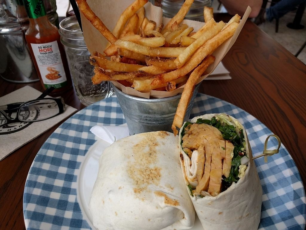 """Photo of South Kitchen + Spirits  by <a href=""""/members/profile/pattib"""">pattib</a> <br/>Superfood Tempeh Wrap with grilled tempeh, cabbage, kale, edamane, crunchy quinoa and sunflower seeds in a flour tortilla. Dressed with tequila lime vinaigrette with a side of fries.  <br/> February 20, 2017  - <a href='/contact/abuse/image/86273/228382'>Report</a>"""