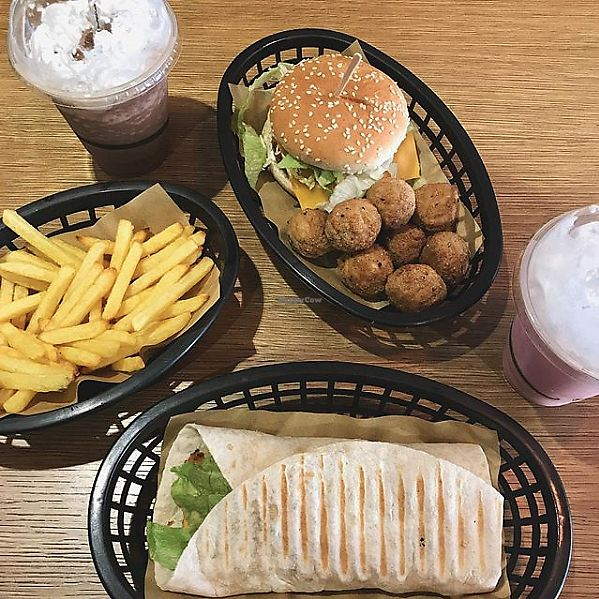 """Photo of Earth Restaurant & Takeaway  by <a href=""""/members/profile/CarissaThorne"""">CarissaThorne</a> <br/>CBC Burger and Chicken Sriracha Wrap with Popcorn Chicken, Air Fries and Chocolate/Strawberry Milkshakes <br/> March 25, 2018  - <a href='/contact/abuse/image/86514/375918'>Report</a>"""