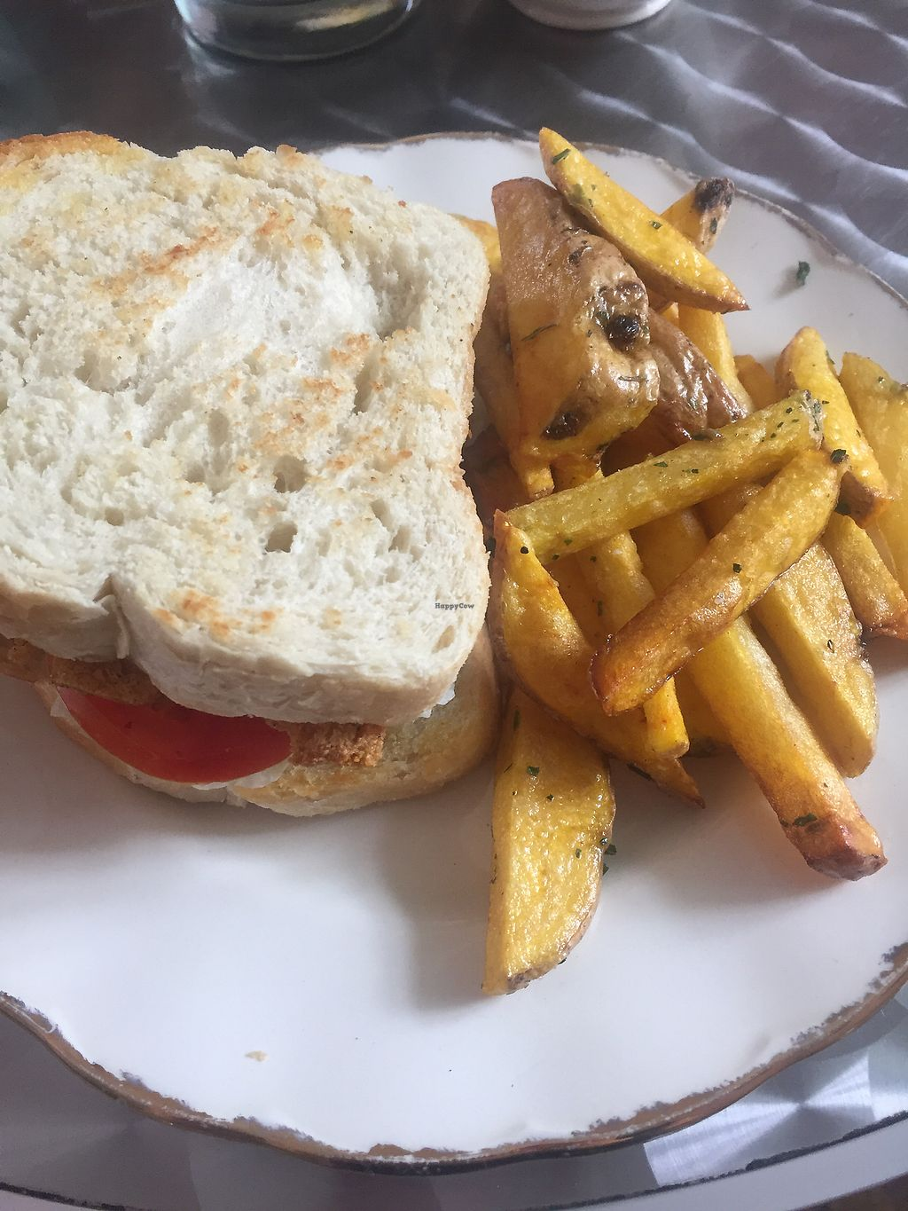"""Photo of The Churro Bar & Vegan Bakery  by <a href=""""/members/profile/amndaxxxx"""">amndaxxxx</a> <br/>Vegan BLT and fries <br/> January 14, 2018  - <a href='/contact/abuse/image/86714/346597'>Report</a>"""