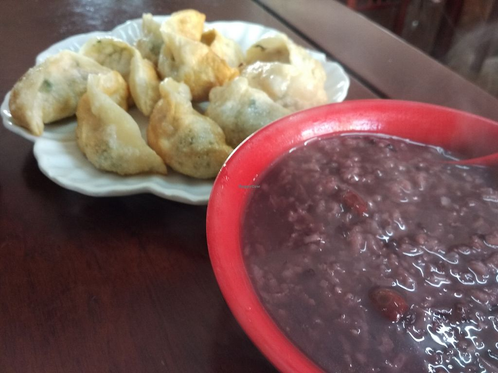 """Photo of Yingjiang Temple Restaurant  by <a href=""""/members/profile/Rizhi"""">Rizhi</a> <br/>Vegetarian food from the Yingjiang temple restaurant in Anqing. Sweet black rice congee with jujubes, and fried dumplings <br/> May 9, 2017  - <a href='/contact/abuse/image/86731/257331'>Report</a>"""