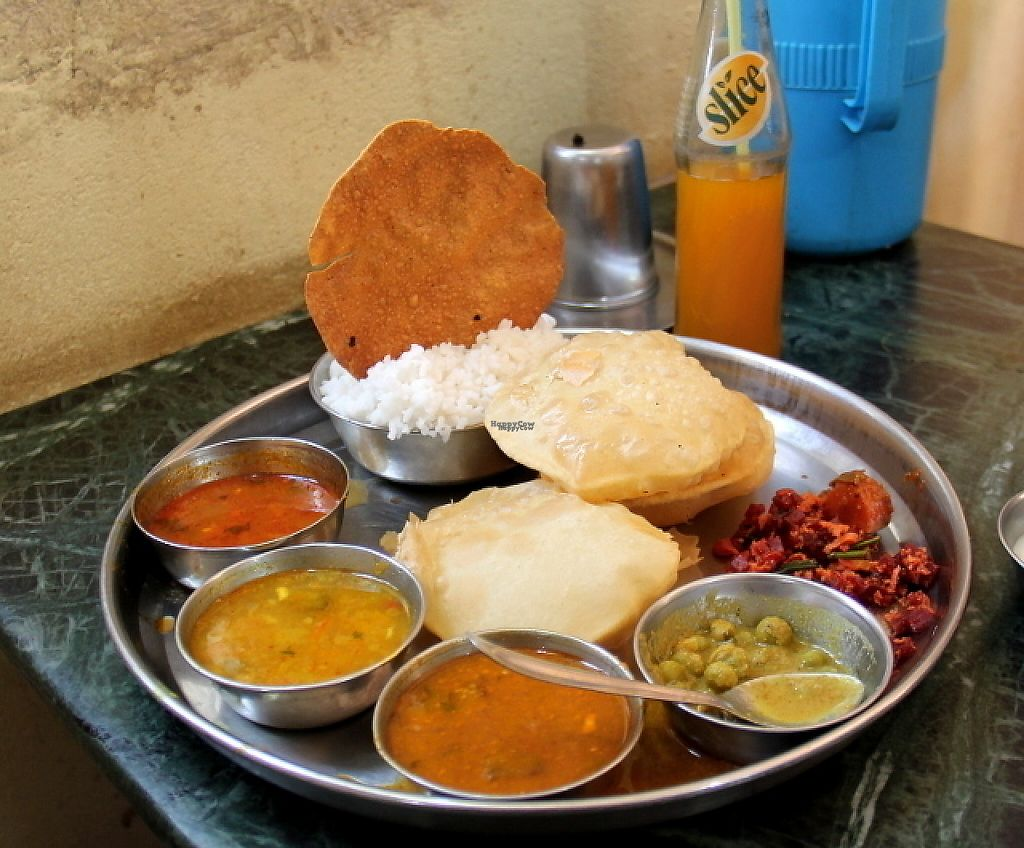 """Photo of Udupi Mallikarjun  by <a href=""""/members/profile/reissausta%20ja%20ruokaa"""">reissausta ja ruokaa</a> <br/>Thali (without the curd and dairy dessert that usually comes with it) plus maaza mango drink. Costs maybe 40 rupiahs.  <br/> March 25, 2017  - <a href='/contact/abuse/image/86860/240809'>Report</a>"""