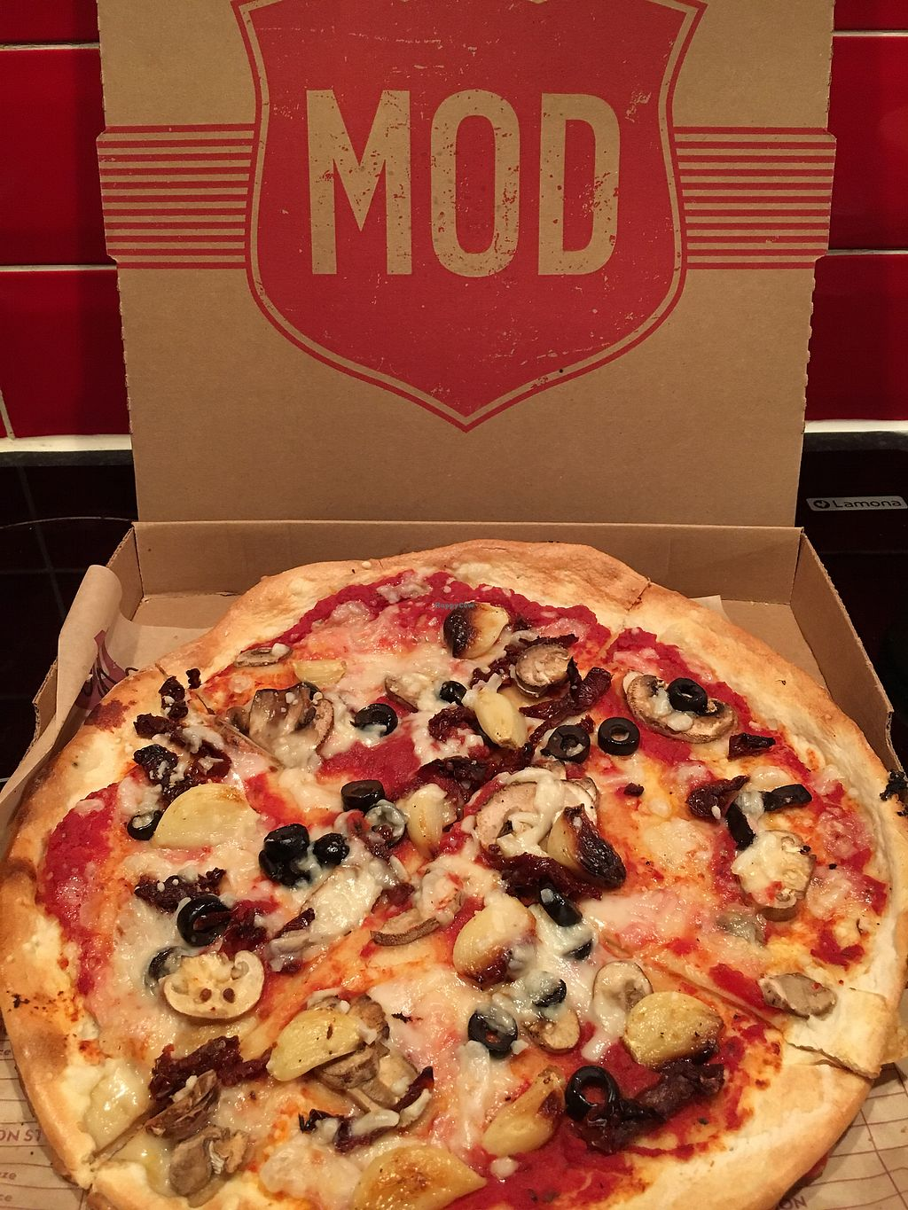 """Photo of Mod Pizza  by <a href=""""/members/profile/hack_man"""">hack_man</a> <br/>Pizza with mushrooms, sun dried toms, garlic & olives  <br/> September 1, 2017  - <a href='/contact/abuse/image/87204/299788'>Report</a>"""
