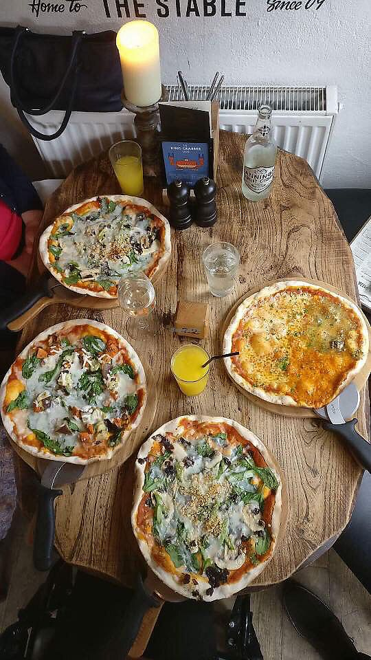 """Photo of The Stable  by <a href=""""/members/profile/Rachel_Violet"""">Rachel_Violet</a> <br/>Three vegan and one veggie pizzas ?  <br/> August 4, 2017  - <a href='/contact/abuse/image/87617/288511'>Report</a>"""