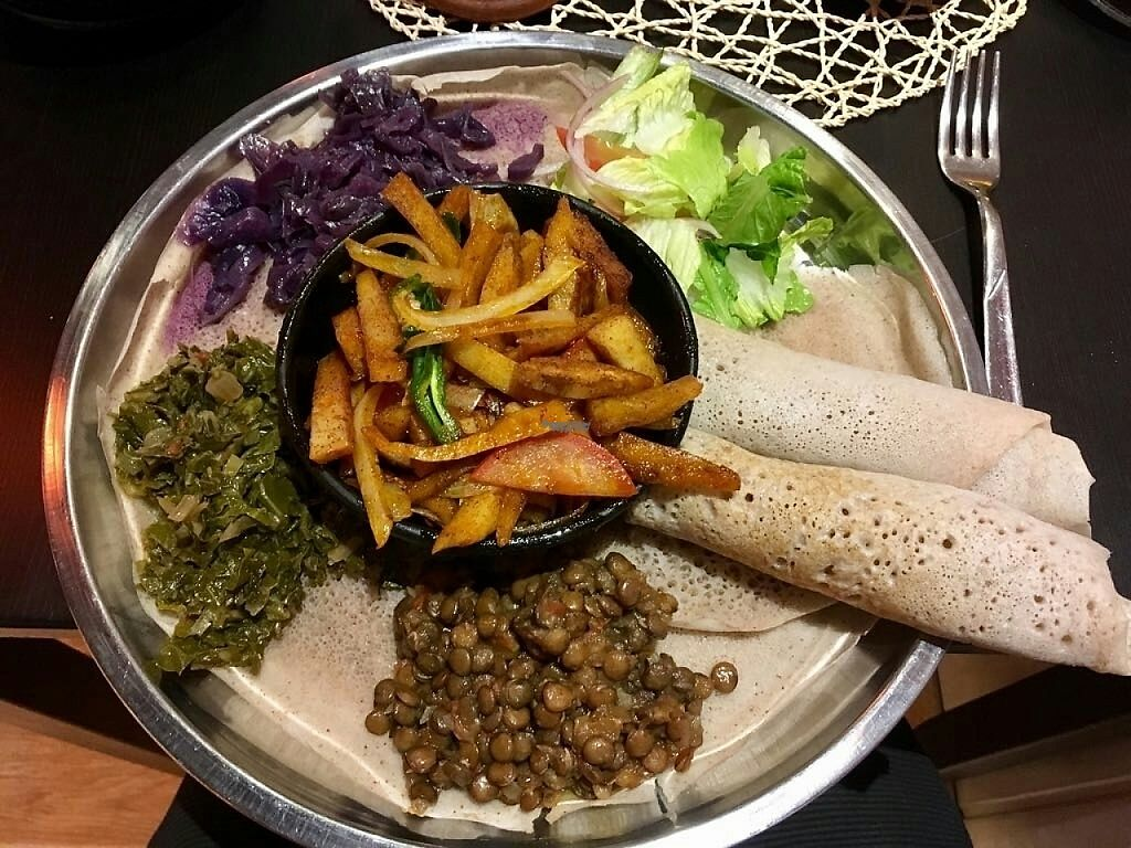 "Photo of Etiopico Afrika  by <a href=""/members/profile/HannaElizabeth"">HannaElizabeth</a> <br/>Vegan Homemade seitan platter for 10€. delicious and filling!  <br/> April 13, 2017  - <a href='/contact/abuse/image/87658/247551'>Report</a>"