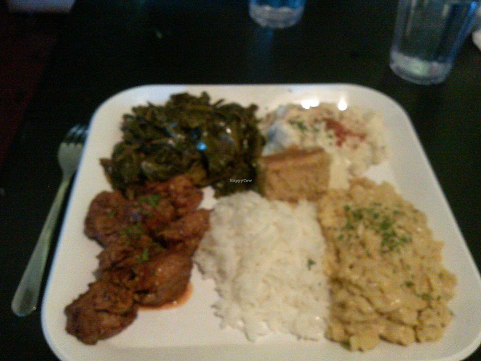 "Photo of Souly Vegan Cafe  by <a href=""/members/profile/AntwanFoster"">AntwanFoster</a> <br/>Mmm mmm mmm I got the POPPIN BBQ PLATTER. And my sides were mac and cheese, seasoned and smoked collard greens, potato salad, rice and cornbread <br/> January 3, 2018  - <a href='/contact/abuse/image/87664/342443'>Report</a>"