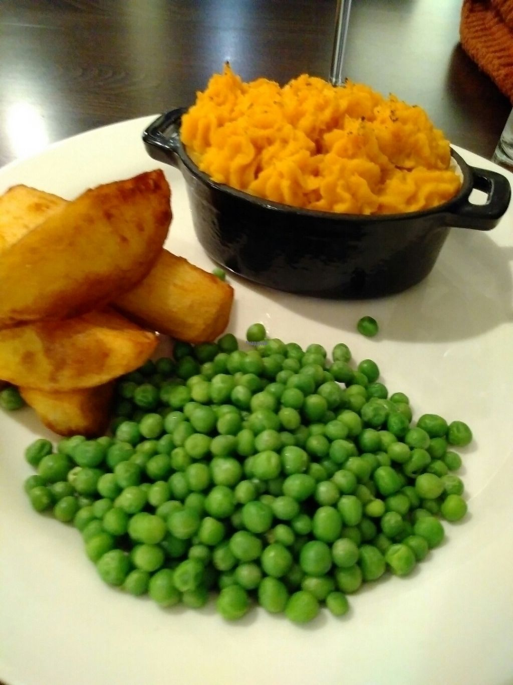 """Photo of Fjara Cafe Bar  by <a href=""""/members/profile/helenstrong"""">helenstrong</a> <br/>Vegan shepherd's pie with peas and chunky fries <br/> February 27, 2017  - <a href='/contact/abuse/image/87770/230932'>Report</a>"""