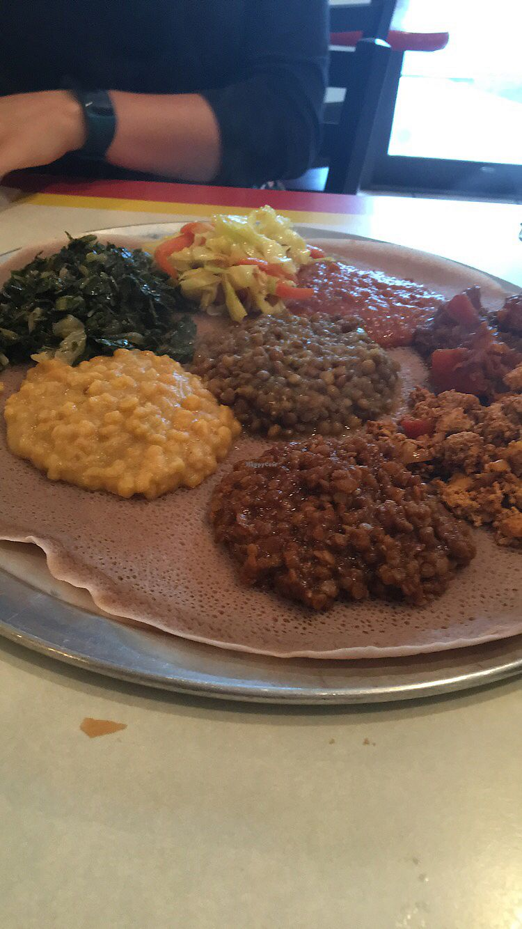 "Photo of Tigi's Ethopian Restaurant   by <a href=""/members/profile/LauraHaines"">LauraHaines</a> <br/>All the vegan options on injera  <br/> July 7, 2017  - <a href='/contact/abuse/image/88002/277538'>Report</a>"