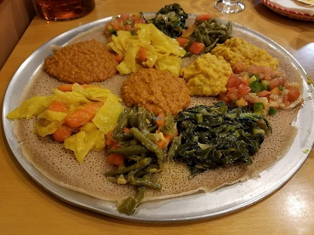 """Photo of Ahadu Ethiopian Cuisine  by <a href=""""/members/profile/MerryRose"""">MerryRose</a> <br/>Veggie Combination #1 platter (for two). Comes with cabbage & carrot, red lentils, split peas, green beans &carrot, collard greens, and tomato salad <br/> March 7, 2017  - <a href='/contact/abuse/image/88234/233668'>Report</a>"""