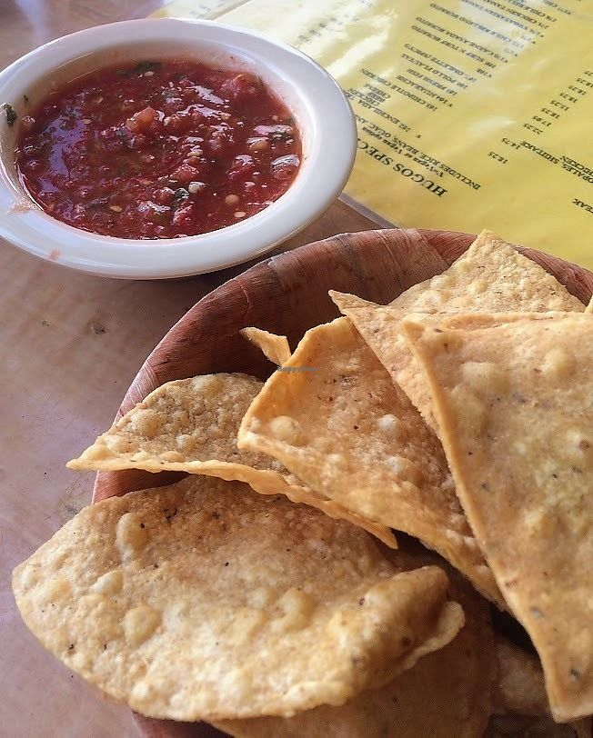 """Photo of Hugo's Cocina   by <a href=""""/members/profile/fullbellyhappyheart"""">fullbellyhappyheart</a> <br/>Chips and salsa while we read the menu. Extensive vegan options (well labeled) on simple yellow laminated paper menus <br/> June 20, 2017  - <a href='/contact/abuse/image/88374/271197'>Report</a>"""