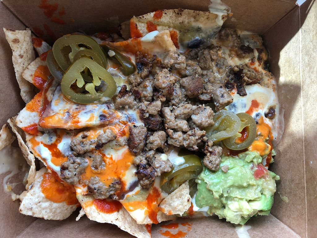 """Photo of The Vegan Nom Food Truck - E Cesar Chavez   by <a href=""""/members/profile/ArielRoberson"""">ArielRoberson</a> <br/>Vegan nachos  <br/> February 6, 2018  - <a href='/contact/abuse/image/88511/355831'>Report</a>"""