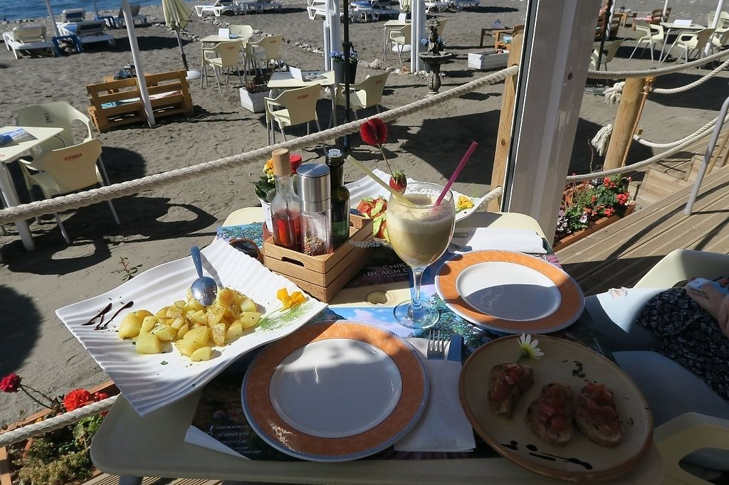 "Photo of Chiki Beach Club  by <a href=""/members/profile/C%26S"">C&S</a> <br/>baked potatoes, bruschetta, avocado-tomato salad and an mango milkshake <br/> April 15, 2017  - <a href='/contact/abuse/image/88880/248327'>Report</a>"