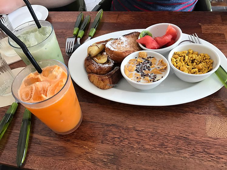 """Photo of Around Green - 어라운드 그린  by <a href=""""/members/profile/luckychinowow"""">luckychinowow</a> <br/>Green tea Latte, Carrot apple juice- Tofu scramble with chick peas and fruit, Banana and toast. All vegan <br/> June 9, 2017  - <a href='/contact/abuse/image/88897/267210'>Report</a>"""