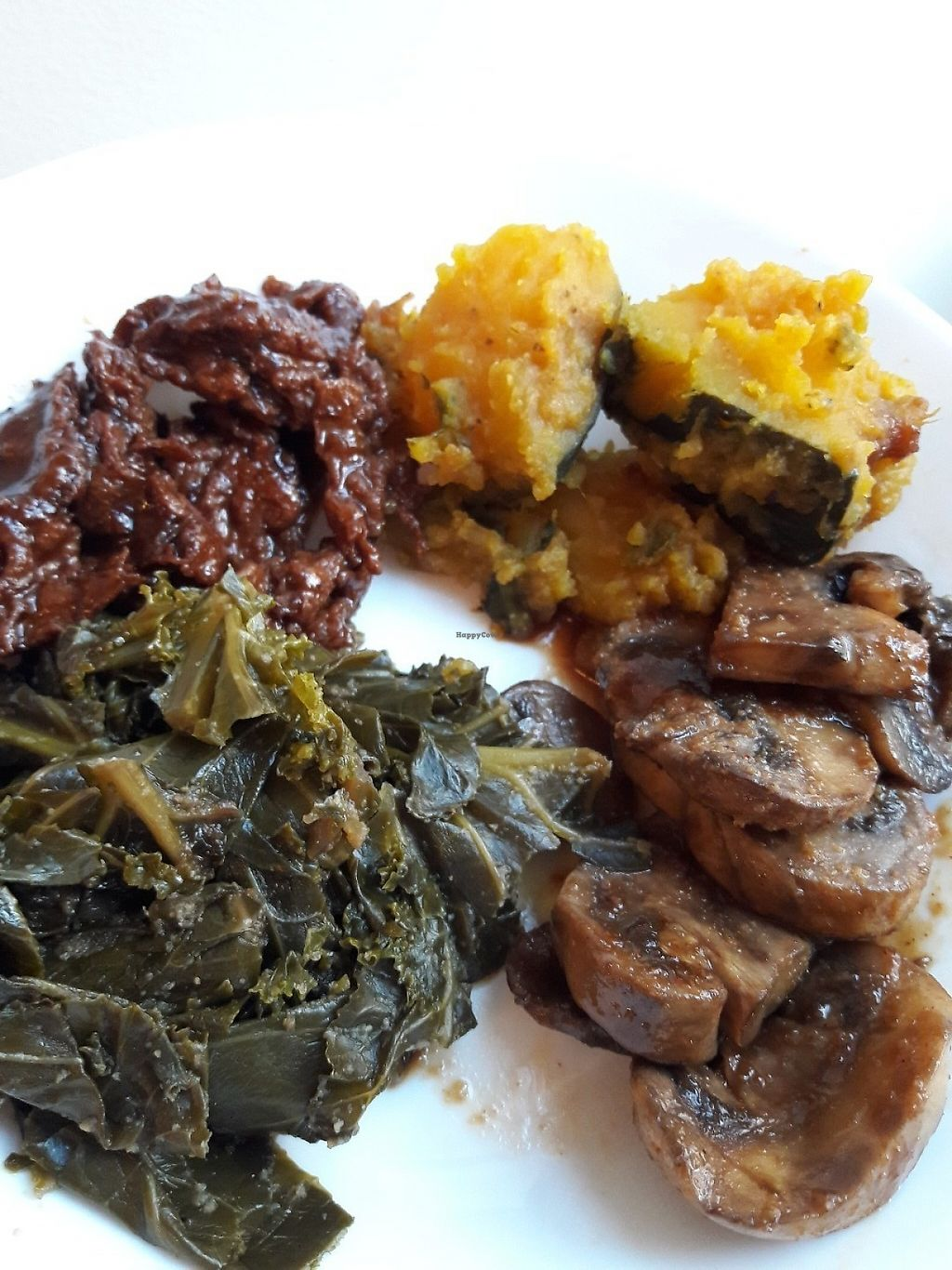 "Photo of Vegan's Choice  by <a href=""/members/profile/Katzmyth"">Katzmyth</a> <br/>Spicy mushrooms, seasoned collards, pumpkin, and soy BBQ meat <br/> May 15, 2017  - <a href='/contact/abuse/image/88928/258920'>Report</a>"