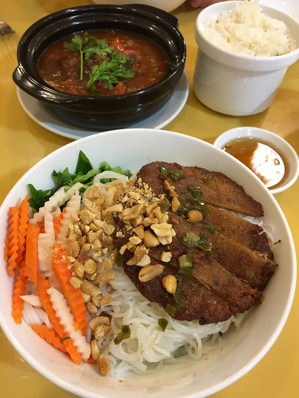 """Photo of Loving Hut Thai Duong  by <a href=""""/members/profile/Theunforbiddenapple"""">Theunforbiddenapple</a> <br/>Pho and vegan fish with tomato <br/> January 26, 2018  - <a href='/contact/abuse/image/89077/351078'>Report</a>"""