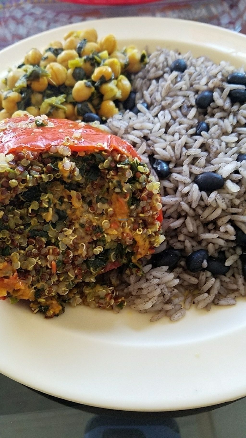 "Photo of La Empanada Llama  by <a href=""/members/profile/ehubert"">ehubert</a> <br/>Quinoa stuffed pepper, rice and black beans, and chickpeas and spinach <br/> March 23, 2017  - <a href='/contact/abuse/image/89098/239634'>Report</a>"