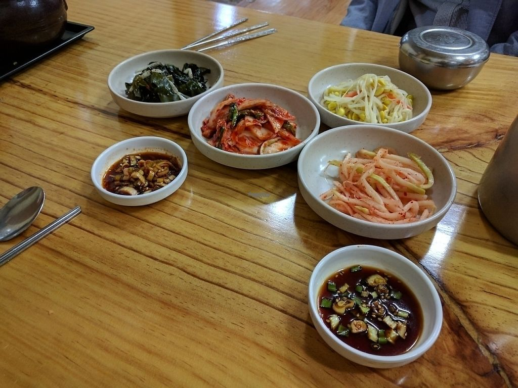 "Photo of Baengnyeonok - 백년옥  by <a href=""/members/profile/PhillipPark"">PhillipPark</a> <br/>Sides. All vegan except for the napa cabbage kimchi in the middle <br/> April 3, 2017  - <a href='/contact/abuse/image/89610/244467'>Report</a>"