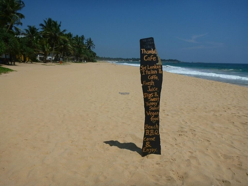 """Photo of Thambili Cafe  by <a href=""""/members/profile/barbicanben"""">barbicanben</a> <br/>Sign on the beach mentioning vegan food <br/> April 3, 2017  - <a href='/contact/abuse/image/89641/244365'>Report</a>"""