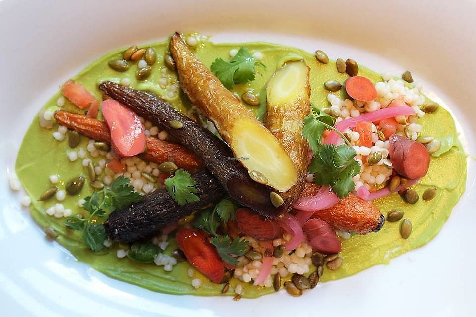 """Photo of Malo  by <a href=""""/members/profile/MelodyVeganJoy"""">MelodyVeganJoy</a> <br/>Cumin-roasted rainbow carrots served with Israeli couscous, avocado purée, fresh pico de gallo, pumpkin seeds, pickled carrots (vegan) <br/> April 5, 2018  - <a href='/contact/abuse/image/89962/381320'>Report</a>"""