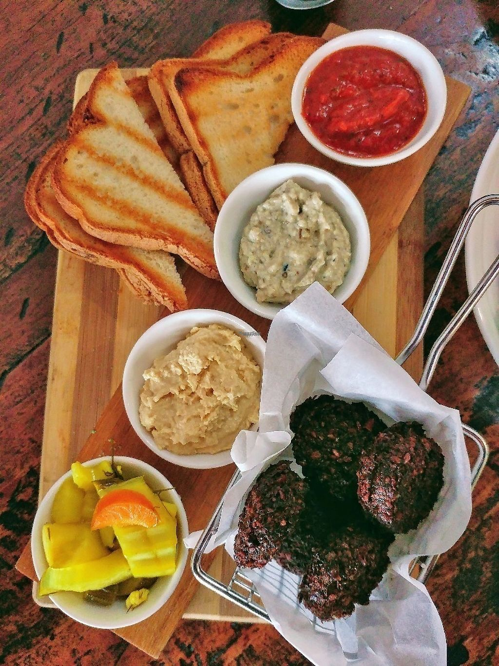 """Photo of CLOSED: Wholistic Foods  by <a href=""""/members/profile/verbosity"""">verbosity</a> <br/>Falafel board served with hummus, baba ganoush, tahini, assorted pickled vegetables + seeded loaf <br/> April 14, 2017  - <a href='/contact/abuse/image/90009/247736'>Report</a>"""
