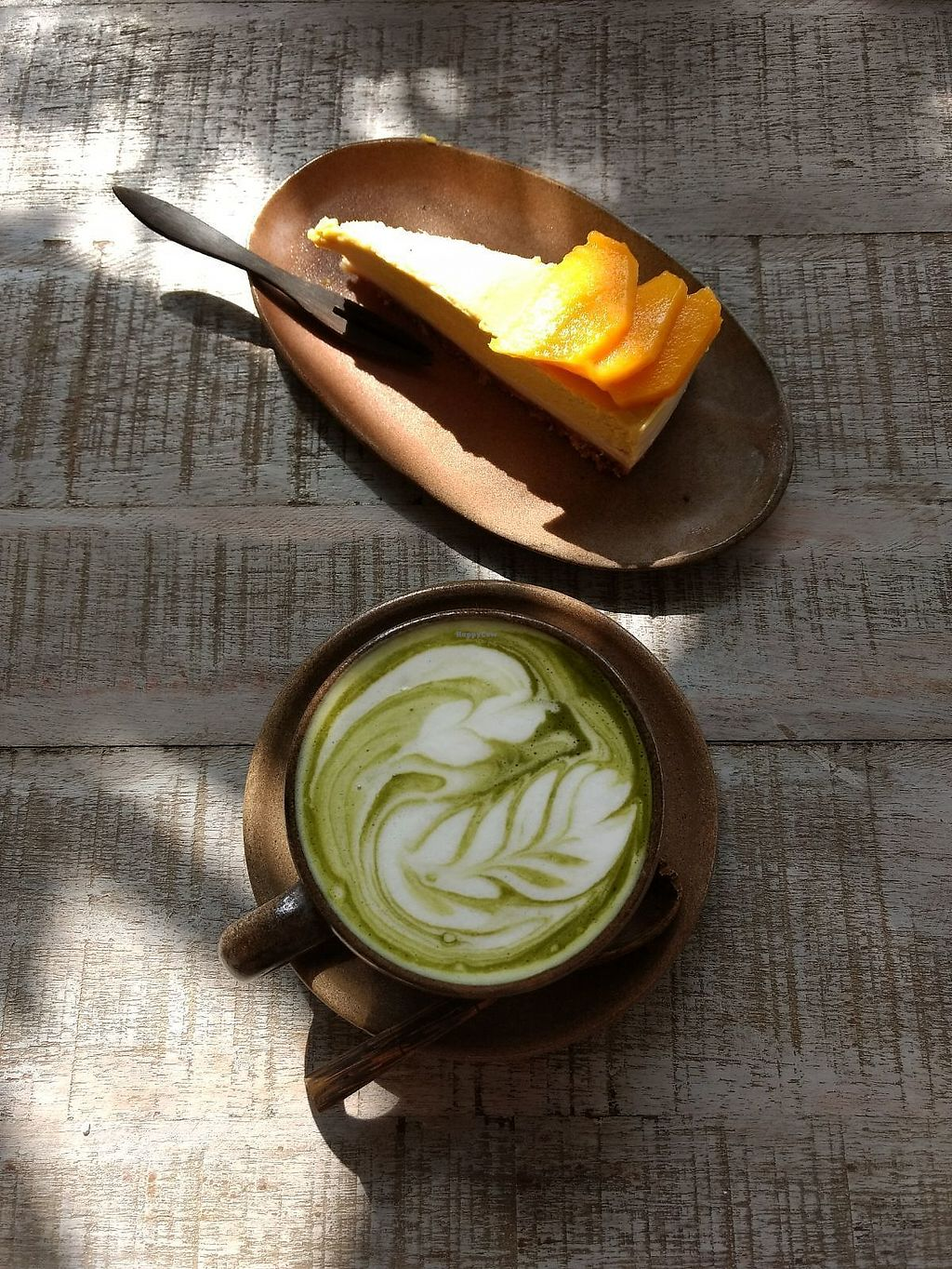 "Photo of Vibe Cafe  by <a href=""/members/profile/Kirsikkatuuli"">Kirsikkatuuli</a> <br/>Matcha latte and mango raw cake <br/> February 23, 2018  - <a href='/contact/abuse/image/90274/362709'>Report</a>"