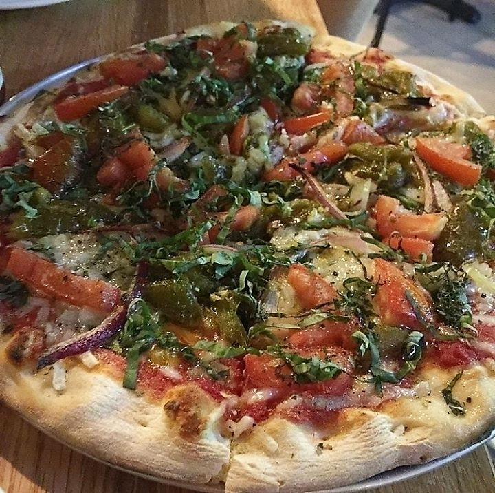 """Photo of Gusto Pizza  by <a href=""""/members/profile/MelodyVeganJoy"""">MelodyVeganJoy</a> <br/>Red sauce, spinach, vegan mozzarella, Mancini fried peppers, red onion, garlic, tomatoes finished with garlic fennel vinaigrette, Gusto pizza spice, fresh basil <br/> April 4, 2018  - <a href='/contact/abuse/image/90306/380443'>Report</a>"""