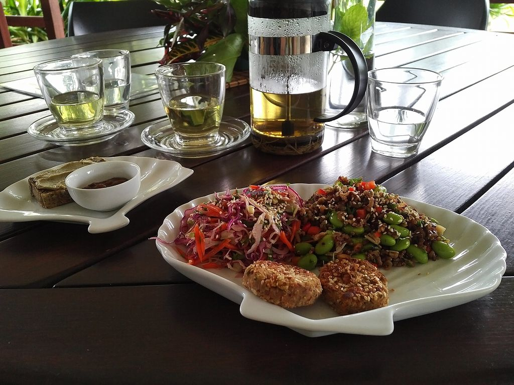 "Photo of Kaingavai Water Garden Tea House & Vegetarian Eatery  by <a href=""/members/profile/VegUnicorn"">VegUnicorn</a> <br/>The Asian brown rice/quinoa entrée option. It came with a quinoa cakes and bread <br/> June 24, 2017  - <a href='/contact/abuse/image/90670/273043'>Report</a>"