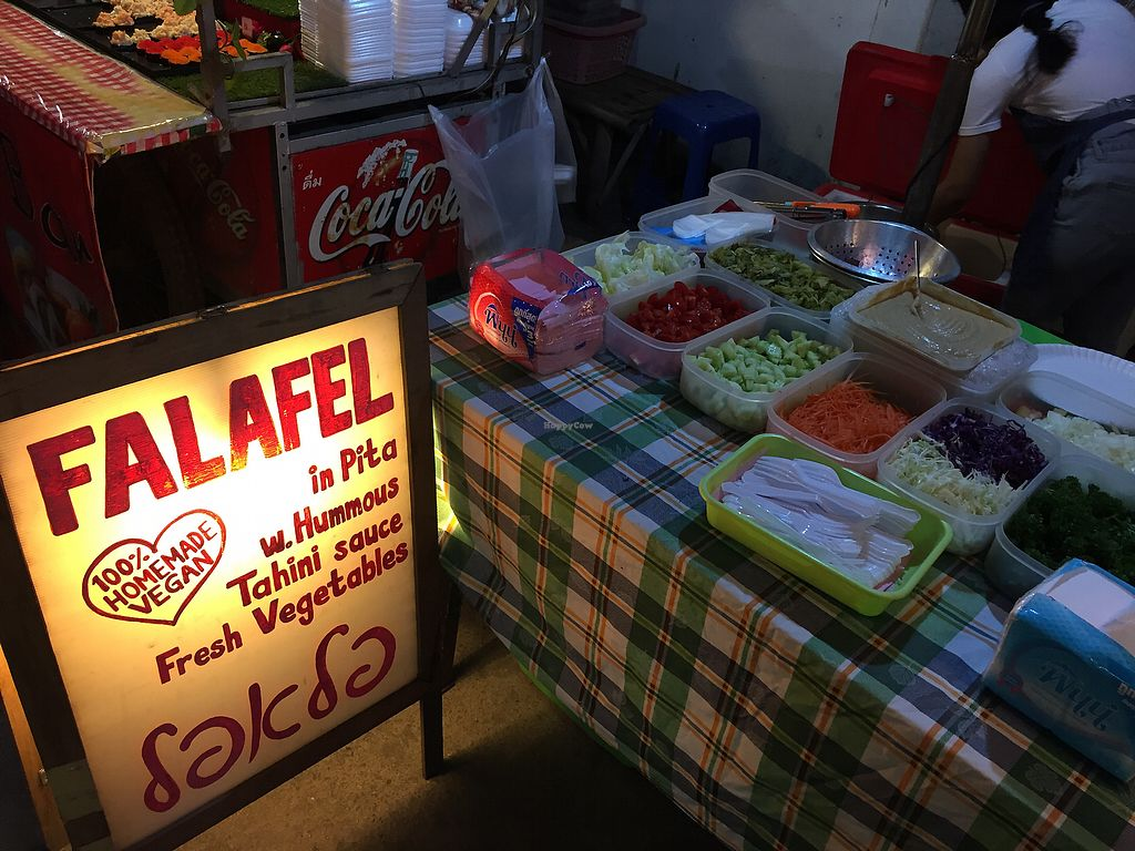 """Photo of Queen Falafel Food Cart  by <a href=""""/members/profile/ClaudiaMarie"""">ClaudiaMarie</a> <br/>Sign, and fresh veggies! <br/> January 26, 2018  - <a href='/contact/abuse/image/90954/351117'>Report</a>"""