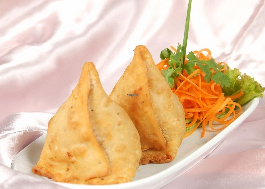 "Photo of Indian Hut  by <a href=""/members/profile/indianhut2016"">indianhut2016</a> <br/>A Savoury appetizer of puff pastry stuffed with spicy potatoes and green peas <br/> April 28, 2017  - <a href='/contact/abuse/image/91111/253338'>Report</a>"