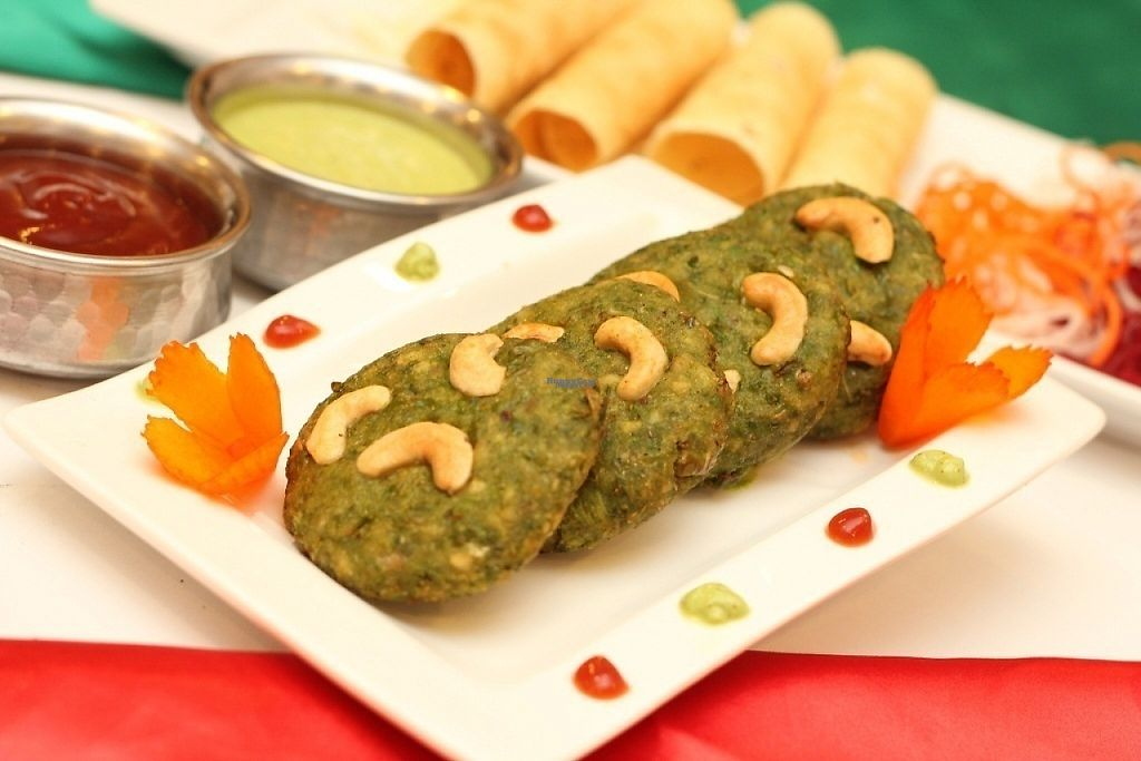 "Photo of Indian Hut  by <a href=""/members/profile/indianhut2016"">indianhut2016</a> <br/>Deep fried vegetable cutlets prepared with spinach and green peas garnished with cashew nuts <br/> April 28, 2017  - <a href='/contact/abuse/image/91111/253344'>Report</a>"