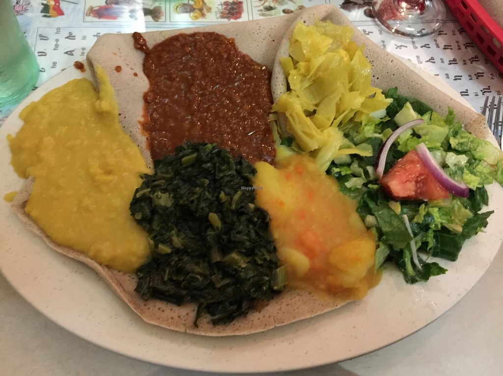 "Photo of Queen Sheba  by <a href=""/members/profile/sncpapa"">sncpapa</a> <br/>'Vegetarian Combo Plate'. Server assured me it was vegan as well.   <br/> January 27, 2016  - <a href='/contact/abuse/image/9116/133937'>Report</a>"
