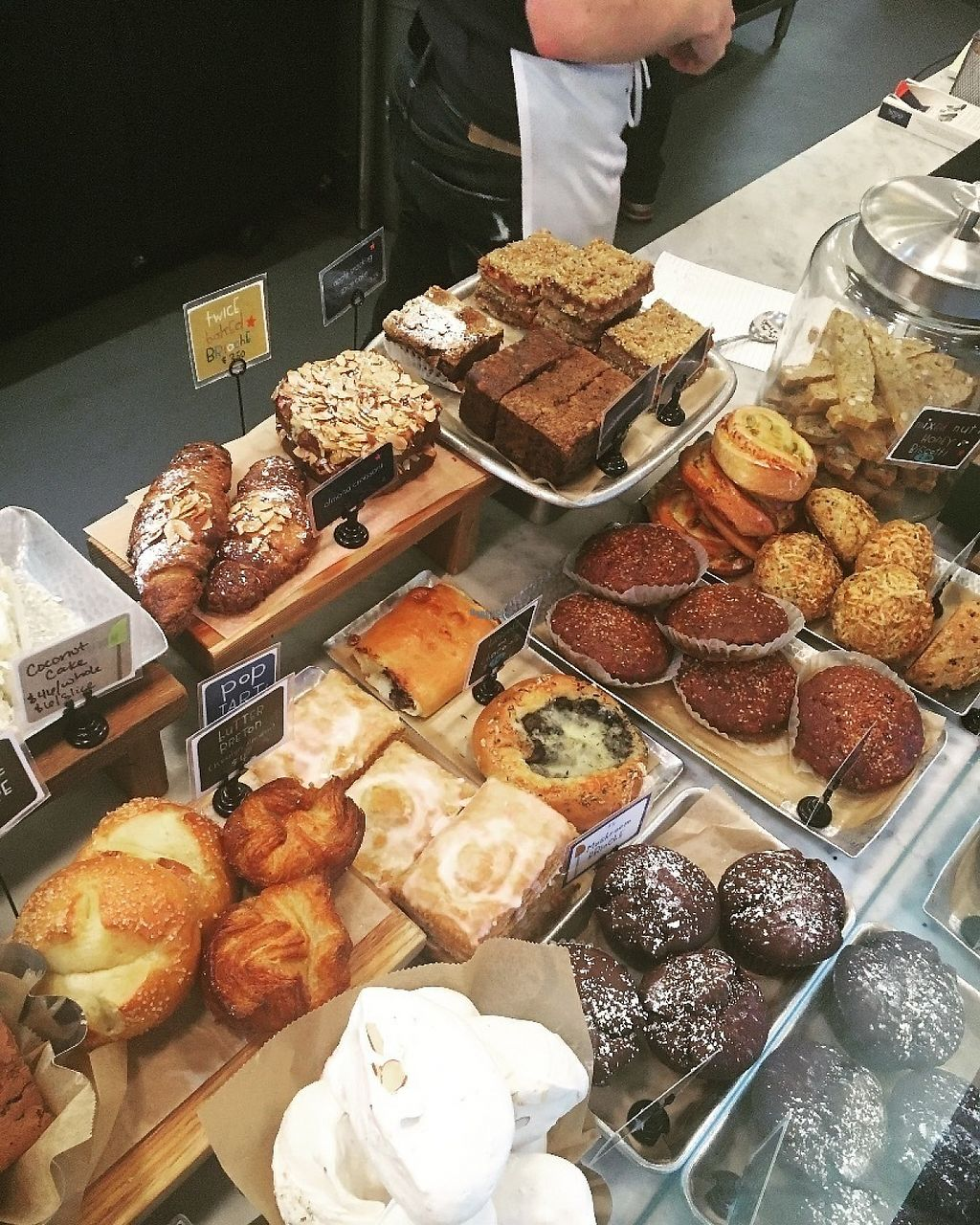 """Photo of Flour Bakery and Cafe - Back Bay  by <a href=""""/members/profile/MaddyLowney"""">MaddyLowney</a> <br/>The bakery case -- ft the vegan low-fat chocolate cake and the monthly vegan muffin (carrot cake flavored) <br/> April 28, 2017  - <a href='/contact/abuse/image/91234/253510'>Report</a>"""