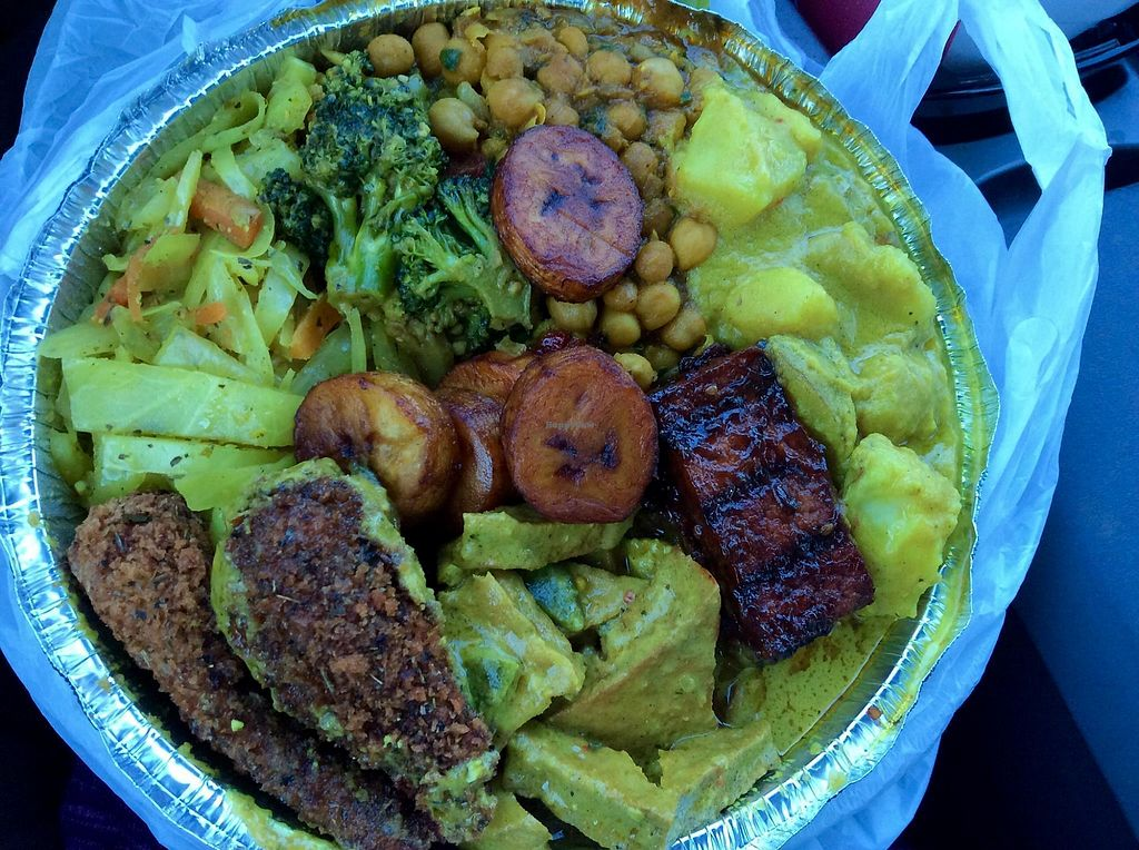 """Photo of Ninth Square Market Caribbean Style  by <a href=""""/members/profile/jujutsuka"""">jujutsuka</a> <br/>large plate:  3 proteins of jerk tofu, curry tofu, drumsticks; and 4 sides of curry garbanzos, curry potatoes, curry veg, and curry cabbage <br/> March 25, 2018  - <a href='/contact/abuse/image/91314/375917'>Report</a>"""