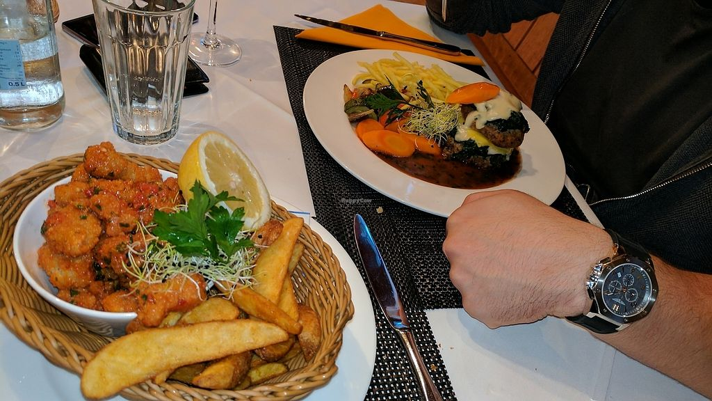 """Photo of Laegernstuebli  by <a href=""""/members/profile/yodimom"""">yodimom</a> <br/>i had crispy chimmi churri vegan chicken with potatos and he had a vegan burger with non dairy chees and spinach ,delicious <br/> July 27, 2017  - <a href='/contact/abuse/image/91420/285391'>Report</a>"""