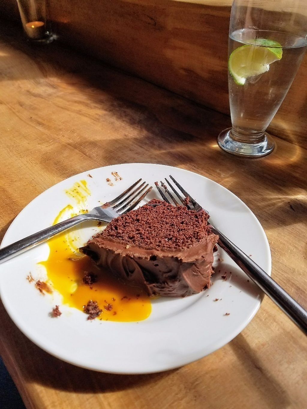 "Photo of The Old Fire Station  by <a href=""/members/profile/aimeelynn"">aimeelynn</a> <br/>Vegan Chocolate Cake (drool) with a mango sauce! <br/> May 20, 2017  - <a href='/contact/abuse/image/91570/260672'>Report</a>"