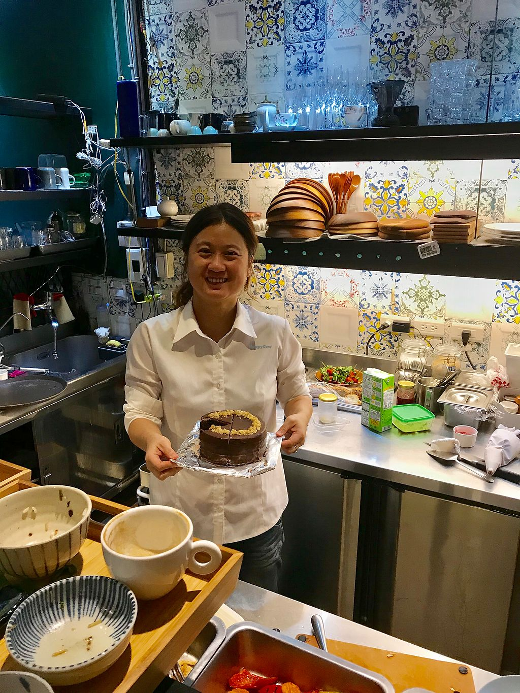 """Photo of Blossom Rena Vegan Cafe  by <a href=""""/members/profile/lachai"""">lachai</a> <br/>Sophie with her delicious chocolate cake <br/> November 22, 2017  - <a href='/contact/abuse/image/91621/328155'>Report</a>"""