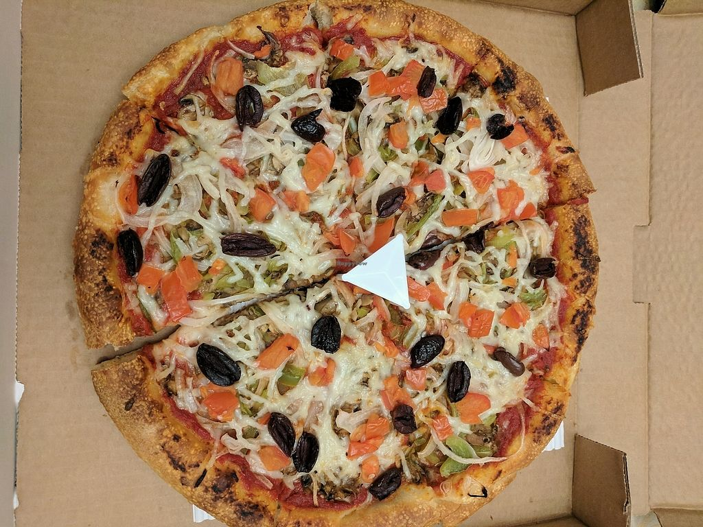 "Photo of Bow Tie Pizza  by <a href=""/members/profile/lmcc"">lmcc</a> <br/>The Vegan - olives, Daiya cheese, mushrooms sauteed in vegan pesto, tomatoes, onions - without pineapple <br/> February 3, 2018  - <a href='/contact/abuse/image/91648/354227'>Report</a>"