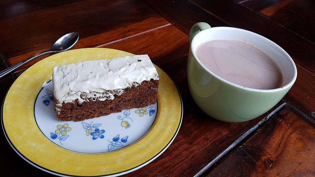 """Photo of Les Gourmandises Louca   by <a href=""""/members/profile/JonJon"""">JonJon</a> <br/>Carrot cake and hot chocolate <br/> July 28, 2017  - <a href='/contact/abuse/image/91706/285769'>Report</a>"""