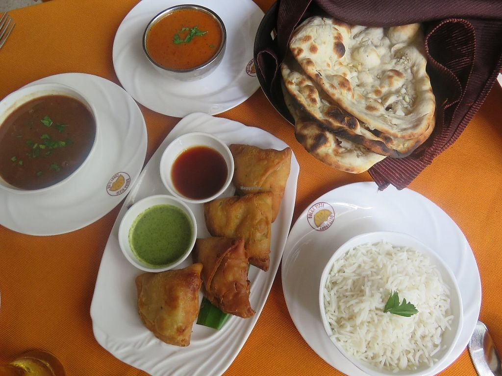 """Photo of Buena Vista Curry Club  by <a href=""""/members/profile/Pinelele"""">Pinelele</a> <br/>Naan bread, rice, curries and veggie samosas <br/> May 22, 2017  - <a href='/contact/abuse/image/91735/261480'>Report</a>"""